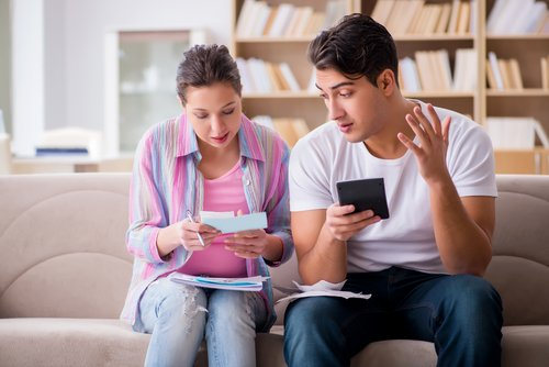Sit together to discuss your monthly budget with your spouse