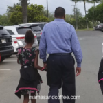 Black father walking with his daughters- I see black people